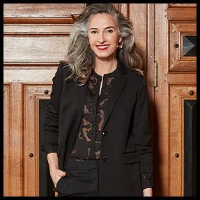 zwarte outfit met doorzichtige zwarte blouse